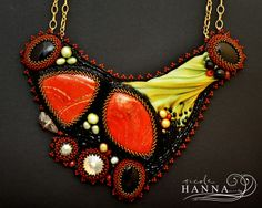 Measuring in at 16 x 13cm (width and length respectively), this creation is for the summer goddess in you. Featuring two large red jasper stones, three black onyx, three golden Swarovski and small freshwater pearl and carnelian accents, this piece is a show-stopping number. A green hand-dyed sil...
