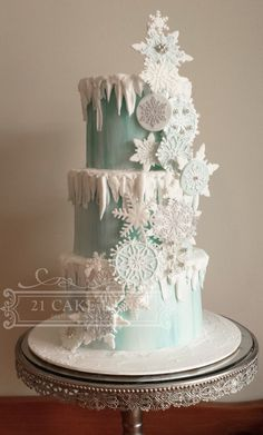 Snowflakes design is made using fondant discs, gumpaste snowflakes and...