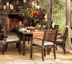 An outdoor dining room with fireplace - yes please!