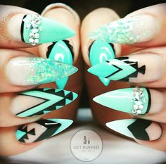 Bright neon green stiletto tribal nailart @king.kisa