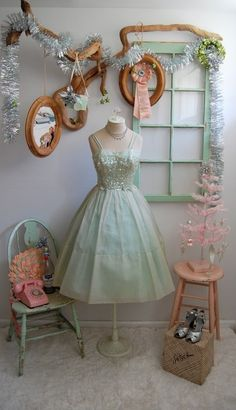 Vintage Vignette with dress and mirrors minus the tinsel