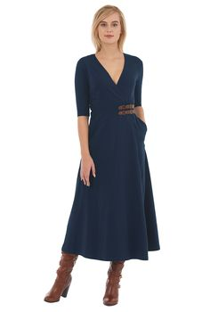 Our cotton jersey knit wrap dress is styled with a cross-over front and cinched with faux leather buckle tabs that provides subtle polish while putting focus on the waist.