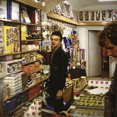 """John shopping at a toy store in Zagreb, Yugoslavia 1979 From Brian's book """"Queen in . John Deacon, Princes Of The Universe, Queen Aesthetic, 90s Aesthetic, Roger Taylor, Queen Freddie Mercury, Queen Band, Brian May, Killer Queen"""