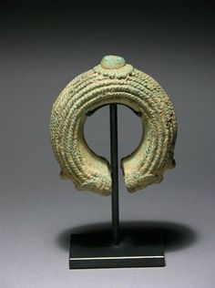 Currency Bracelet. Kru, Liberia | Date unknown, found in an archaeological dig | Cast copper