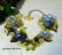 """'My Friend's Blue Pansy Garden Bracelet' by K for """"Trifles & Whimsy"""" on Etsy.  Vintage Lucite Flowers and Leaves, Swarovski Crystals"""