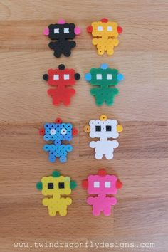My kids love perler bead crafts and this round up of perler bead craft ideas has so many great projects that they would be happy to make. Perler Bead Designs, Easy Perler Bead Patterns, Melty Bead Patterns, Hama Beads Design, Beading Patterns Free, Knitting Patterns, Perler Bead Disney, Perler Bead Art, Pearl Beads Pattern