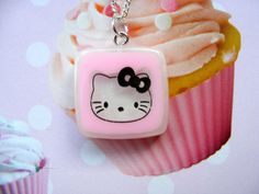 Everybody's favourite kitty..its Hello Kitty! This is a super cute little Hello Kitty pendant, with a sparkly background, hanging on a silver-plated chain.