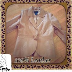 Tan 100% Leather Jacket Light Mocha Color 100% Leather Jacket. Jacket closes with one snap covered by a flower like design. Jacket is fully lined & has a band like design @ waist. In great condition. Metro Style Jackets & Coats