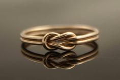 Simple Elegance It is called the Infinity Knot and available on Esty for $224.00. http://www.etsy.com/listing...
