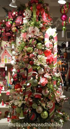 beautiful tree in soft pinks and greens click on the image to find more photos of this designer decorated tree.  Email shelley@shelleybhomeandholiday.com to order ornaments and florals used to create this tree.