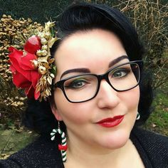My Sweet friend @ladydamona  rocking the Candy Cane Earrings for Christmas   Merry Christmas everyone! I finally have the time to post a selfie  today wearing my christmas candy cane earrings from @glitterparadise and a fabulous new Red rose glitter hairpiece by @sophisticatedladyhairflowers  Russian Red lipstick by mac with gloss layer on top from @besamecosmetics  #selfie #me #ladydamona #looherk #style #vintage #retro #blackhair #redlips #mac #hairflower #glitterparadise #glasses…