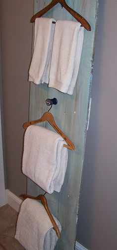The use of these hangers as towel bars would be more interesting if you used vintage ones with advertising printed or impressed on them and then hung them on interesting hooks - old metal schoolroom hooks, antique doorknobs, tiebacks, etc.