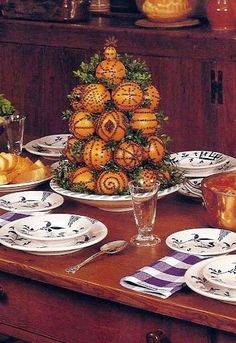 Williamsburg Pomander Centerpiece - Consists of cone-shaped wooden form 10 inches high, 5 inches wid. Primitive Christmas, Noel Christmas, Country Christmas, Christmas Oranges, Xmas, Orange Christmas Tree, Christmas Tablescapes, Christmas Centerpieces, Victorian Christmas Decorations