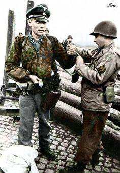"herrwiegenstein: ""A Waffen-SS Untersturmführer is searched, his watch confiscated by an American GI shortly after his capture. """