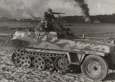 Caught on camera in the thick of battle is an Sd.Kfz. 250/1 with a group of armed Waffen-SS troops. The half-track is storming an unidentified village in one of the many counterattacks that took place against strong Soviet troops assaulting German position on Dnieper River in the autumn 1943. The vehicle still carries the old camouflage pattern, composed of sand spots applied on the dark gray background.
