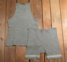 "From the 1920's. Antique, 2-piece Swimsuit. Light Gray, Wool knit with White stripes at Leg bottoms. Auctiva's FREE Counter. Shorts have a Drawstring Waist for fit adjustment. Waist (straight across waistband // x 2): 16 1/2"" ( 33"" total) . 