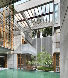 """""""constructed completed in cast-concrete- at its core, courtyards, ponds and lush greenery combine to create a rural and urban typology in this residential…"""""""