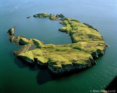 Ellidaey a crater island close to the sailing route of the Bredafjordur ferry m. Stykkisholmsbaer former Helgafellssveit