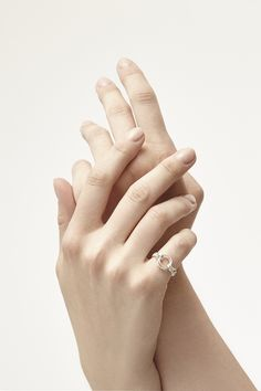 This very simple chain ring is sized for the pinky finger. The chain gracefully wraps around the finger to meet the circles. Double plain twisted...