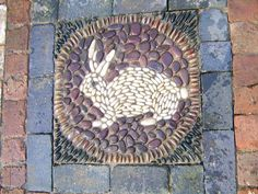 Rabbit mosaic as a patio feature by SueRewMosaics.