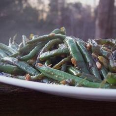 Sweet and Spicy Green Beans - 3/4 pound fresh green beans, trimmed,  2 tablespoons soy sauce,  1 clove garlic, minced,  1 teaspoon garlic chili sauce,  1 teaspoon honey,  2 teaspoons canola oil,