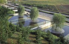 Interesting tree island design at the Center for Advanced Science and Technology in Japan by PWP Landscape Architecture.