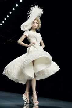 White dress because she is pure as the driven snow
