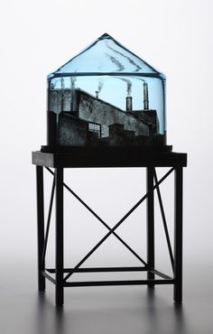 """Multitalented artist Jeremy Lepisto combines hand-blown glass with black and white photos of urban scenes. The innovative process involves """"printing"""" the photos on the inside of the glass. The water inside warps the image into strangely beautiful scenes. Illusion, Kiln Formed Glass, Art Of Glass, Architecture Drawings, Water Tower, Modern Glass, Hand Blown Glass, Fused Glass, Stained Glass"""