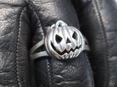 Silver Jack-o-lantern ring. $79.00, via Etsy.