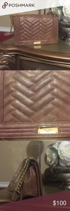Gorgeous bcbg purse Gorgeous bcbg shoulder pay, purse. Coffee / chocolate color with gold shimmer. Absolutely beautiful. Pictures don't do it justice . Bcbg  Bags Shoulder Bags