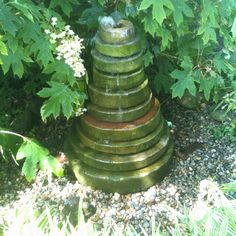 Old graduated grinding stones turned into a pond less fountain.