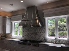 Handcrafted Custom Stainless Steel Vent Hood with Mirror Finished Bands #luxurykitchens #luxuryhomes #customhomes #interiordesign #kitchenrenovations #kitchenmirrors #venthoodenvy #beachsheetmetal