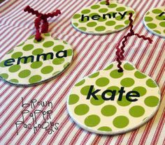 wooden ornaments, modpodged with scrapbook paper, add names - great for packages!