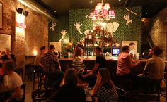 Keep your eyes peeled because some of Sydney's best bars are tucked away out of sight, signalled only by a scrap of light under the door, a queue in an alley, or the sound of revelry as the door swings shut