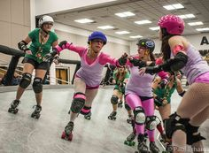 Banked track action with the South Side Roller Derby.