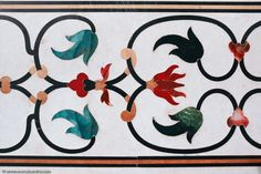 Taj Mahalby Marc Shandro The Art of Parchin Kari – Marble InlayThe parchin kari at the Taj Mahal is one of the finest quality examples of the era.At the Taj, the technique is used most spectacularly to depict well observed blooms and flowering plants.Similar to the Italian technique known as 'pietre dure', a variety ofcolored stones including lapis lazuli, carnelian,agate and garnet, were used to achieve stunning depictions of the colorful flowers of India.Even greater detail was…