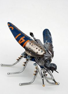 This clever creature was fashioned out of a pneumatic spark plug cleaner, Illinois license plate, shoe trees, lawn sprinkler, bicycle brake levers, model airplane engine cylinder, mountain bike suspension pivot and old typewriter parts