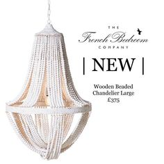 NEW  Seaside chic with an Ibizan vibe this heavily distressed wooden beaded chandelier has necklaces of large beads strung onto hessian string that hang from hammered metal supports painted in a white distemper. The beads criss-cross at the base in an unstructured manner giving it a charming and relaxed vibe - simple luxury.  We are styling ours amongst funky neon lights velvets and brightly coloured embroidery pompoms and tassels (akin to Kit Kemps designs from the famous downstairs bar at…