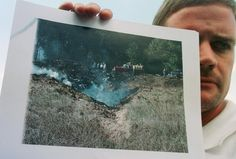 Mark Stahl of Somerset, PA, displays a photo he took early on after United Airlines Flight 93 crashed outside of Shanksville. Mark heard the crash & wandered up to the site before the area was blocked off by rescue workers. World Trade Center Collapse, Trade Centre, United Airlines Flight 175, 11 September 2001, Bodies, 911 Never Forget, Flight 93, The Two Towers, Airline Flights