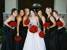 Black bridesmaid dresses with Red Bouquets   Krystle Akin Photography   Theknot.com