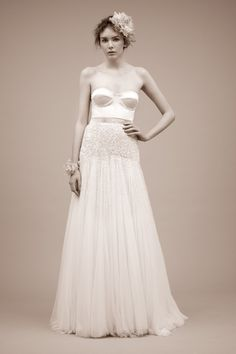 I would make the bustier white lace, a sparkly band and the skirt a bit fuller with layers of tulle and lace as the top layer