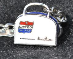 VINTAGE UNITED AIRLINES STERLING SILVER CHARM WITH BRACELET AND 4 MORE CHARMS