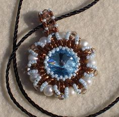 Swarovski crystal surrounded by seed beads, crystals, and freshwater pearls.  $35.00   sarah@crystalpaintbrush.com