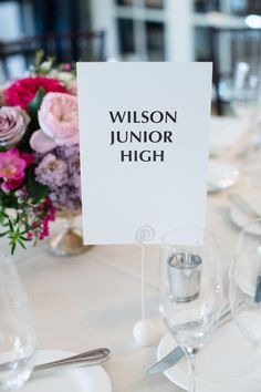 Creative wedding table name idea - tables named after significant location in the couple's relationship {Powers Photography Studios}