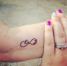 Love you to the moon and back tattoo. Infinity symbol tattoo. Moon tattoo. Heart tattoo.