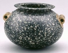 Spheroidal vase of black-and-white porphyritic diorite with a rounded base and two tubular handles, the rim is thin, flat-topped and sharp on the outer edge, both handles are covered with rectangular plates of thin gold, cut out into an openwork cross, the interior is well-hollowed. 2nd Dynasty (?)1st Dynasty (?)