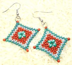 This pair of earrings are one of my favorite color combinations, in turquoise, terra cotta and silver! I started with size 6 Czech seed beads