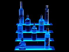 Show off your top shelf spirits with this colored LED lighted liquor bottle display. Bar shelves has four tiers and is operated by wireless remote control. Bar Shelves, Display Shelves, Liquor Shelves, Shelving, Display Cases, Display Stands, Liquor Cabinet, Led Diy, Liquor Bottles