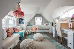 Pink beaded chandelier adds a pop of color with ombre colors in a girl's attic bedroom design.