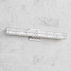 An energy-efficient LED bath light fixture with clear crystal squares and a sleek chrome finish.